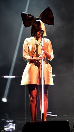 Going incognito: Sia once again kept her face under wraps as she performed on the latest episode of The Graham Norton show, set to air on Friday night Old Singers, Female Singers, Sia The Greatest, Sia Kate Isobelle Furler, Sia And Maddie, Norton Show, Women In Music, Inspirational Celebrities, Comics