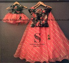 Kids frocks design - Lovely mom and daughter duo Beautiful orange color lehenga and black color top with floral print 23 September 2017 Mother Daughter Matching Outfits, Mother Daughter Fashion, Mom Daughter Matching Dresses, Girls Frock Design, Baby Dress Design, Kids Dress Wear, Kids Gown, Baby Frocks Designs, Kids Frocks Design