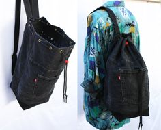 a durable, large capacity denim backpack, washable and multipurpose- use it for a shopping day in town, as a beach bag, a gym bag, a school bag (a hardcover A4 folder fits comfortably inside) or even a nappy bag. made from vintage Levi jeans in very good condition.  * strong, adjustable 100% cotton straps that feel nice on skin * full lining with 2 inner pockets, one with YKK zipper  color: slightly faded black  height - 47cm/18.5 bottom- 19cm*19cm/7.5*7.5 (square) strap length - max…