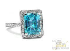 White Gold ring with an amazing light blue Zircon and diamonds.