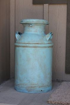 i love old, refinished milk cans! i always used our old milk cans as a chair at the table when we had family get togethers as a kid. :)