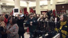 Gospel choir flash mob surprises shoppers at Macy's State Street in Chicago