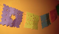 Making real, authentic papel picado takes patience and dexterity. If you want to make a quick, fun mini-version with the niños, here's a fun craft to do. Mini Faux Papel Picado What you need: