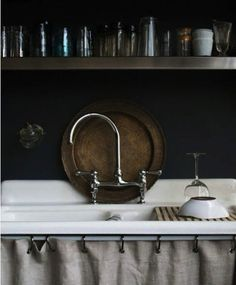 Dark gray walls, copper and linen accents, and open storage are a winning combination.