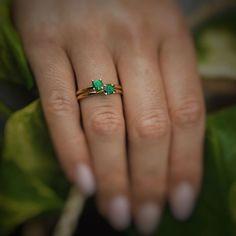 A tropical green 5 mm Tsavorite Garnet set in 14K solid white gold