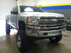 """2012 Chevy 1500 6inch lift kit with 3 inch body lift 35""""tires 20""""wheels procomp lift Toyo open country tires fuel hostage wheels"""