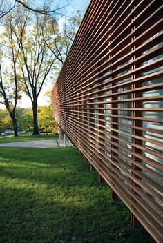 Why not this instead of burglar bars? Modern facade with slatted Cumaru wood screen, Dan Rockhill, Lawrence, Kansas Timber Battens, Timber Screens, Wood Slats, Modern Exterior, Exterior Design, Burglar Bars, Wood Facade, Marquise, Facade Architecture