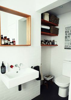 "I love this bathroom! I know it's a little bit... ""dude"", but I love it. The 3D mirror/shelf is brilliant."