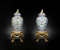 A fine and rare pair of large blue and enamelled 'double-eagle' baluster vases and covers, 18th century, the stands later