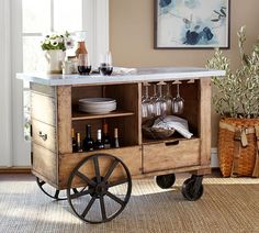 Based on a vintage industrial cart crafted of repurposed materials, our character-rich bar captures the rustic appeal of the original.