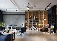 HAO Design Studio is behind this stunning loft in Kaohsiung City, Taiwan. The industrial space was designed for a couple and their record collection, plus their parade of three furry felines (but it would make a killer bachelor pad as well). A striking mix of materials is used throughout the apartment. Bright marble floors were swapped out for a more subdued and modern concrete. A large iron panel greets guests with an image chosen by the owners. An exposed brick wall sets the tone in the…