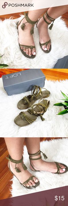 LOFT Leather Olive Green Sandals EUC olive green LOFT brand sandals. Very cute and scrappy. Sandals have two long tassels that you wrap around the ankle and makes for a very cute boho look. The leather lining on the straps are a bit worn out which is why I am pricing it at $15. Comes with original box! Bundle 2+ items in my closet to save 10% 🤗 !!! (Not Free People - tagged for views!) Free People Shoes Sandals