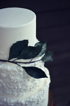 Elegant modern wedding cake with bas relief detailing and branch of large sugar leaves. Elegant Modern Wedding, Cake Shop, Custom Cakes, No Bake Cake, Pillar Candles, Special Events, Wedding Stuff, Wedding Cakes, Candle Holders