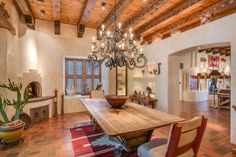 Adobe style dining room with gorgeous iron scroll-arm chandelier