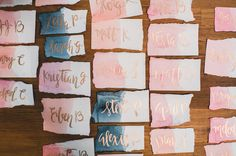 Dip dyed escort cards with gold calligraphy