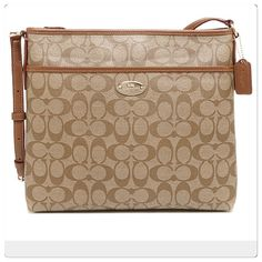 """COACH Signature Cross body Shoulder Bag Purse Brand new with tags!  Signature C printed PVC coated canvas with brown leather trim and polished golden tone hardware. Lined interior with zippered pocket, two open slip pockets and a pen slip. Zippered top closure; Exterior front open slip pocket.  Adjustable single long shoulder and cross-body strap. Strap Drop: up to 22""""  Bag Measures approximately 12"""" (L) x 101/2"""" (H) x 2""""  Comes with Coach care card and gift receipt. Coach Bags Crossbody…"""