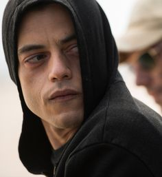 Mr. Robot , kinda like Michael Scofield in prison preak , intelligent , Distant, handsome , a leader