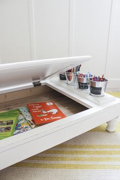 Turn an old kitchen cabinet into an adorable, portable child's desk complete with storage and a chalkboard. Rachel from Shades of Blue Interiors shows us how!
