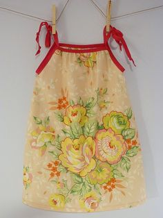 Aww, this is so cute-a pillowcase dress. Blog post refers to this tutorial: http://littlebiggirlstudio.blogspot.com/2009/02/pillowcase-dress-tutorial-dress-girl.html