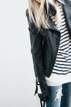 leather jacket layered over simple stripes and distressed jeans