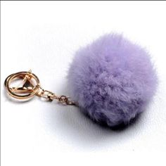 🍄Host Pick🍄Super Cute vegan Fur Pom Pom Ball 100% brand new. Trending hot in 2016. Goes well with your keys, purse, wallet, phone, camera or basically anything. Different colors to choose from that are pale pink, hot pink and lavender. Make an offer while they last. Price firm. Any questions are welcome. Thank you and namaste 🍃 Accessories
