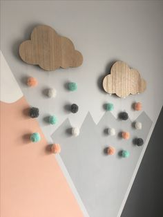 Next cloud lights customised with hand pace pom pom. Girl's nursery peach, grey and mint mountain theme