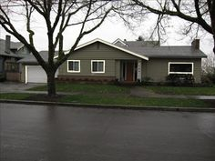 images of houses with green siding | How about a dark sage green?
