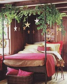 Decorating the bedroom. Red bedding, garland, and stars or snowflakes hanging from the ceiling. #LuxuryBeddingRed