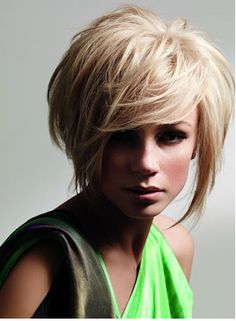 I LOVE this one... so so much - once my hair is long enough.. I want this cut