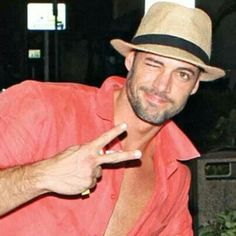 William Levy giving a wink with a nice Coral Shirt & Fedora Hat! William Levi, You Are So Gorgeous, Coral Shirt, Fedora Hat, Mannequin, Panama Hat, Hot Guys, Eye Candy, Handsome