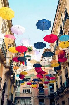 What could be more fun than an umbrella street? Alicante, Spain  Find guides at http://it.jillmy.com/