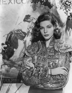 SUPER BOLERO | Lauren Bacall, in Hollywood in 1949, wore a heavily embroidered torero-style jacket....