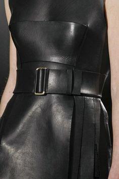 Black leather dress; structured fashion details // Calvin Klein