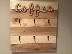 """This beautiful handmade coffee cup/mug rack holds up to 6 cups for easy and convenient storage giving your kitchen that rustic farmhouse look. COFFEE sign is a wooden cutout stained in a natural color with the rest of the rack stained in Puritan Pine with (2) coats of polyurethane There are (6) black matte finish hooks to hold your cups/mugs The dimensions are 18"""" Wide x 20"""" Tall x 2"""" Deep There are 2 heavy duty keyhole hangers on the back of the rack for easy and secure hanging Mounting ha Coffee Signs, Wooden Cutouts, Farmhouse Decor, Keyhole Hanger, Coffee Cup Rack, Mug Rack, Rustic Kitchen, Rack, Coffee Cups"""
