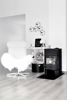 By the Fireplace. Cozy design Sunday by the warm fireplace. Take a look at this Scandinavian living room!