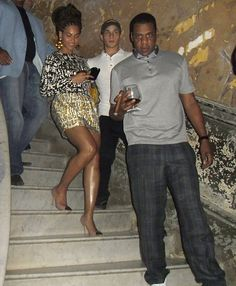 Beyonce's brown and mustard tweed printed dress from Diane Von Furstenberg's Pre-Fall 2012 collection