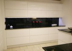 'Ansa' style handleless kitchen in a white high gloss lacquered finish. Available made to measure.