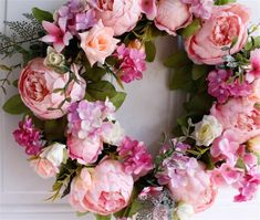 (FAUX PEONY FLOWER HEADS) pink flower blooms, abundant silk foliage, wispy blossoms, Handcrafted on a sturdy, durable grapevine wreath base. The Mixed Peony Wreath coordinates perfectly with the Mixed rose Centerpiece. Silk Flower Wreaths, Flower Garlands, Sunflower Wreaths, Floral Wreaths, Artificial Garland, Artificial Peonies, Spring Door Wreaths, Wreaths For Front Door, Dried Flowers