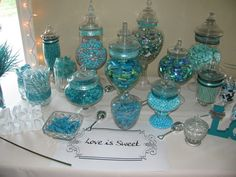 Teal Candy Bar: MIstakes aplenty (but pretty) tongs for soft items!! and labeling, they all need it. And narrow neck jars are impossible for guests to get candy out of.