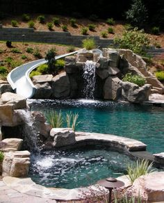 Exact Pool Design with hot tub, Slide,gratto, waterfalls, exc... Must Have this same Natural Stone and Water Look