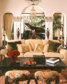 I love pretty much everything about this British Colonial Livingroom.   Evokes a sense of travel to far away places.