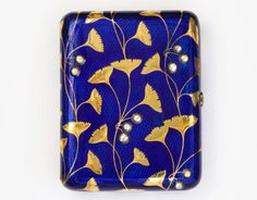 Fabergé Cigarette case c. 1910. Gold gingko leaf, blue enamel and diamond. A La Vieille Russie, New York.