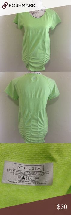 Large Athleta Workout Top Lime green workout top. In good used condition. 50% polyester, 45% nylon, 5% spandex. Bundles welcome :) Athleta Tops Tees - Short Sleeve