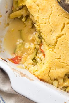 Vegetable cobbler of zucchini, corn, yellow beans, and tomatoes with cornbread topping by The Wimpy Vegetarian. #SundaySupper