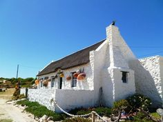 This tranquil fishing village on the north-east of Cape Agulhas in Marcus Bay is known as one of the world's best hideaways! Seaside Getaway, Seaside Towns, Fishermans Cottage, Cape Dutch, African House, Visit South Africa, Farm Paintings, Dutch House, Learning Websites