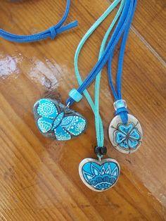 Hand painted pebble pendants