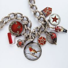 A collection of red themed antique and vintage bracelet charms – robin bird, ladybird ladybug, London guard, star, Tunbridge Wells | Silver Star Charms