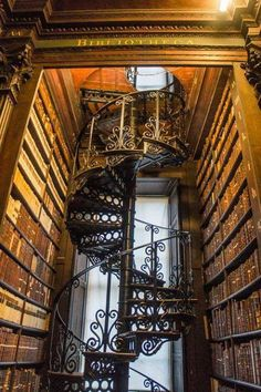 "gatsbywise: ""ancientorigins: ""Trinity College library, Ireland"" Another amazing library and stairway art - this one just got added to my bucket list. - notice the sign at the top of this opening. """