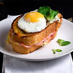 What is a Croque Madame? It's a delicious French Ham, Cheese and Egg Sandwich commonly eaten in bars or cafes across France. Want to How to make a Croque Madame? Stop by for the recipe. Egg Sandwiches, Sandwich Recipes, Brunch Recipes, Breakfast Recipes, Brunch Food, Grilled Ham And Cheese, Breakfast Desayunos, Breakfast Ideas, Good Food