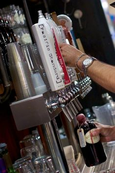 """grocery retailer to offer a refillable container wine on tap. They're calling the new venture """"Old Schoolers"""" and the classic glass jugs, with a fittingly simple no-frills logo, come in 12 oz, 32 oz, and 64 oz sizes. The concept is simple: you buy a reusable jug, bring it to the bar area in the back of the grocery store and have one of the bartenders fill it up with one of the several wine varietals. Gotham Project Wines are the exclusive wine distributor for the Old Schoolers launch, with 6…"""